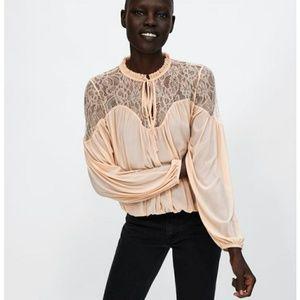 Zara lace blouse with elastin hem endings